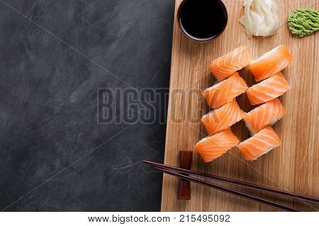 A Classic Philadelphia Roll With Wasabi, Ginger And Soy Sauce On A Wooden Board. Salmon, Philadelphi