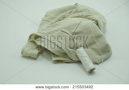 Old Tank Top Needle and thread isolated on white background sufficiency economic concept.