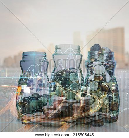 Double exposure of stack of coins and mix coins in clear bottle on blurred photo of cityscape and financial graph with cityscape background Business Trading and investing concept