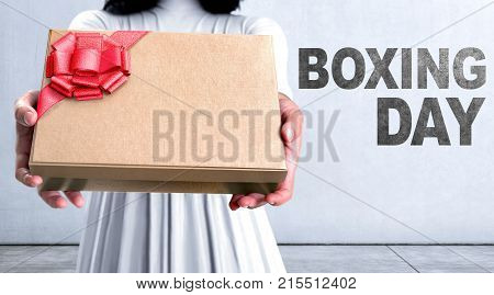 Closeup Woman Hand With Gift Box And Boxing Day Message