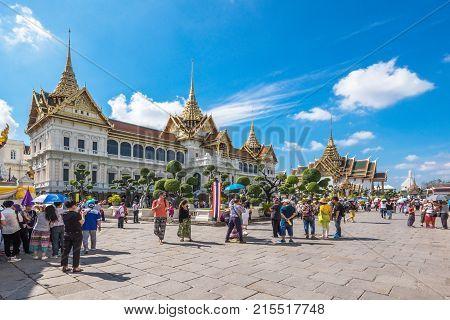 BANGKOK, THAILAND - JANUARY 9 : Tourists visiting Phra Thinang Chakri Maha Prasat in the Grand Palace, Bangkok, Thailand. The Grand Palace is the most city's famous landmark.