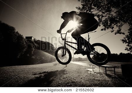 boy jumping on bmx inside splashes
