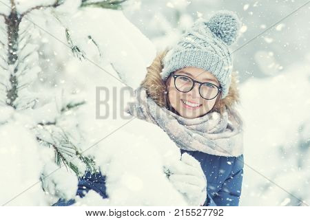 Beauty Winter Girl Blowing Snow In Frosty Winter Park Or Outdoors. Girl And Winter Cold Weather