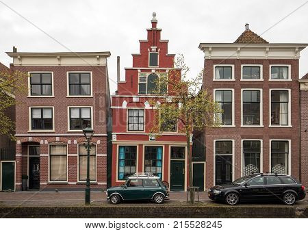ALKMAAR NETHERLANDS - APRIL 21 2017: Historic old town of Alkmaar North Holland Netherlands typical canal houses