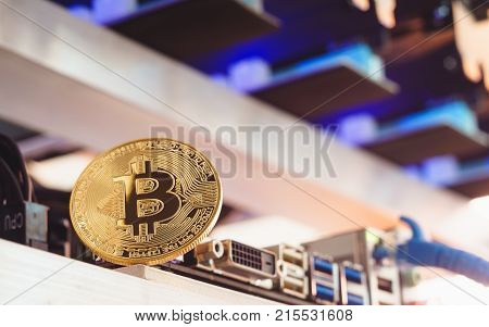 Bitcoin Cryptocurrency Background Concept - Golden Bitcoin With A Computer Graphic Card Or Gpu Rig C