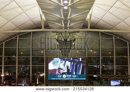 CHEK LAP KOK, HONG KONG - OCT 19, 2017: An advertising screen promotes products on offer to departing passengers at Chek Lap Kok airport Terminal 1