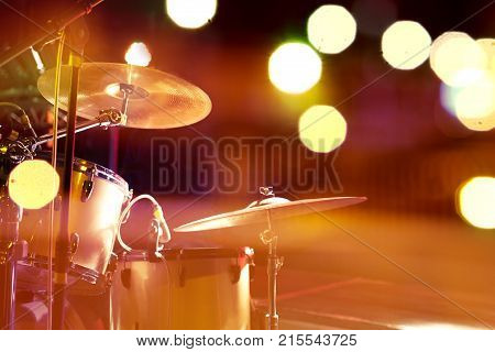 Live music background.Drum on stage and concert lights.Night leisure and entertainment