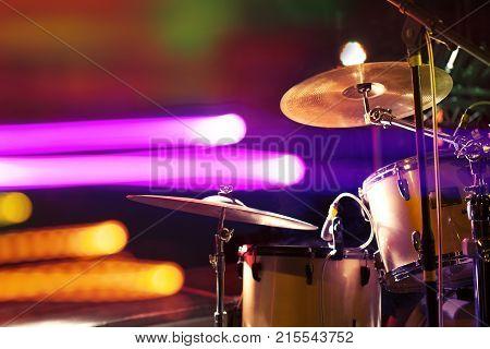 Live music background. Drum on stage and concert lights.Night leisure and entertainment