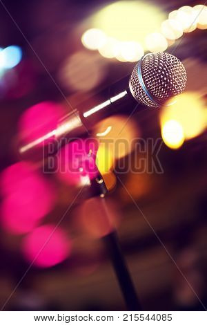 Live music background. Microphone and stage lights.Concert and music concept