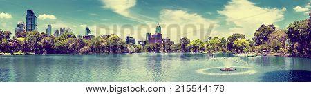 Scenic landscape park and skyscraper.Lake and trees.Scenery cityscape Bangkok Lumphini park