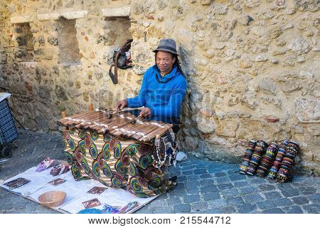 Undefined Young Street Musician Play On Wooden Xylophone In Lisbon. Portugal