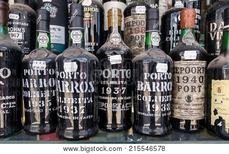 Old Dusted Porto Wine Bottles For Sale At Wine Store. Local Market In Lisbon. Portugal