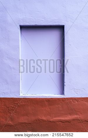 The homogeneous background wall is dyed with brown and purple paint. Hidden window. The background of the concrete fence.
