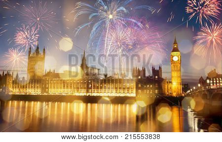 Big Ben with fireworks - celebration of the New Year at the House of Parliament, London, United Kingdom