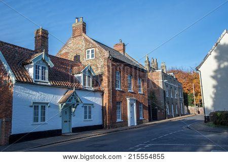 Town houses in typical English village street. Wymondham UK. Pretty market town in Norfolk England.