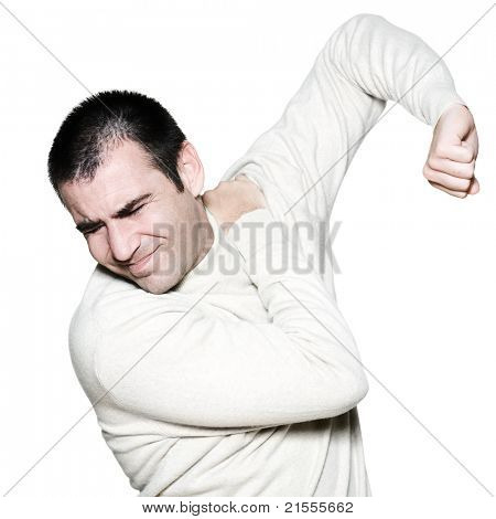 Portrait of a handsome expressive painful man holding shoulder on studio on white isolated background
