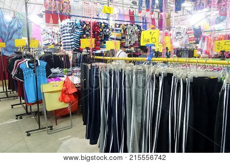 SINGAPORE- NOV 06 2017: Stall that sell clothes in the night market in Singapore. Singapore's night markets have much to offer the discerning traveler
