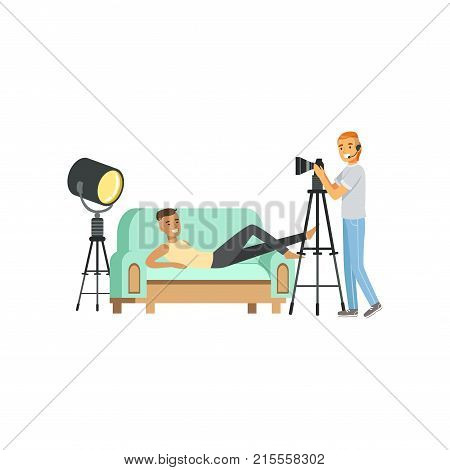 Cartoon guy model character posing lying on couch. Smiling man photographer with headphone and professional camera on tripod. Shooting process in photo studio. Isolated flat design vector illustration
