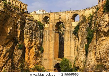 background view of the valley, rock and Ponte Nuevo in Ronda, Andalusia, Malaga