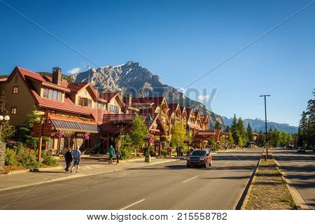 BANFF, ALBERTA, CANADA - JUNE 27, 2017 : Scenic street view of the Banff Avenue in a sunny summer day. Banff is a resort town and popular tourist destination.