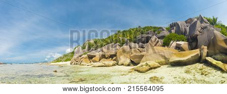 Beautifully shaped granite boulders and a perfect white sand at Anse aux Cedres beach, La Digue island, Seychelles
