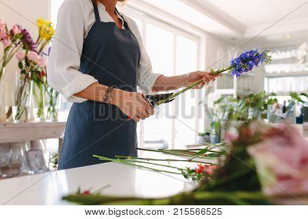 Female Florist Creating Bouquet
