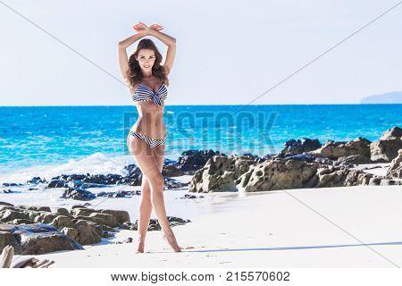 Beautiful woman in bikini on beach at Thailand
