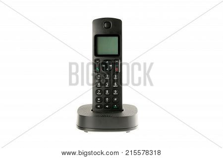 modern cordless dect phone with charging station isolated on white background