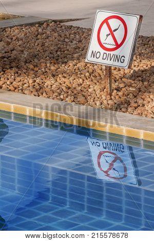 No Diving Warning Sign at the Poolside extreme closeup.