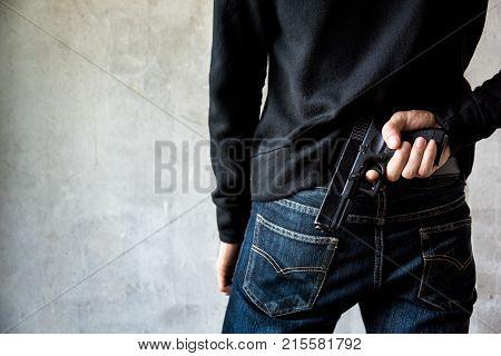 Man Hid Gun Behind Their Back
