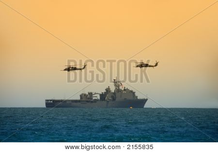 Helicopters Hovering Over Military Ship