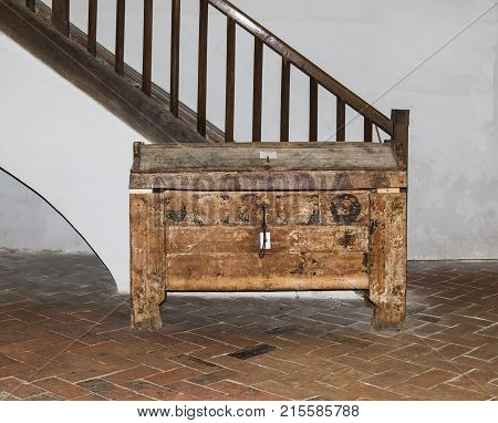 Sighisoara Romania October 08 2017 : The chest stands near the staircase in the Church of the Deal (St. Nicholas) in the castle in Old City. Sighisoara city in Romania