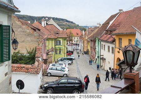 Sighisoara Romania October 08 2017 : School Street in the castle of old city. View from the balcony of the cafe La Scara (On The Ladder). Sighisoara city in Romania