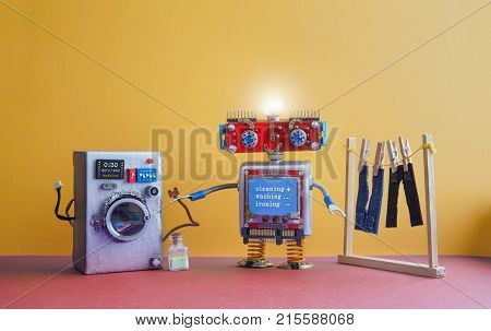 Robot automation laundry room. Robotic washer with message Cleaning, washing, ironing. Silver washing machine, men's jeans pants dried on clothesline with clothespins. yellow wall interior, red floor. Funny toys creative design