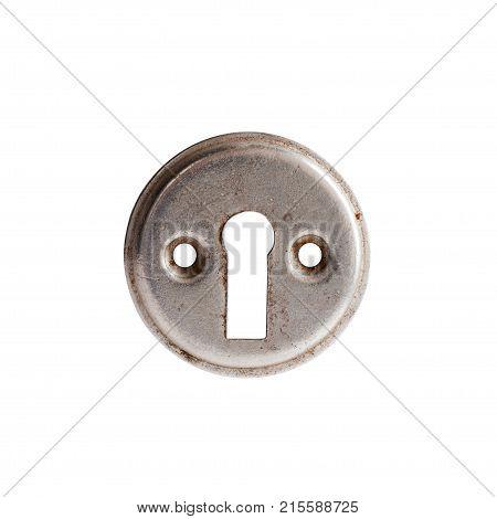 Vintage keyhole isolated on white background. Macro view photo