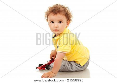Little Boy Plaing With A Toy Car