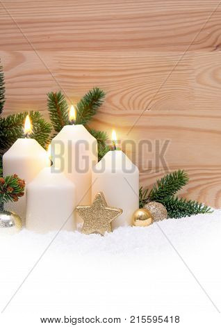 Christmas background with four white advent candles and golden decoration.Fourth Advent.