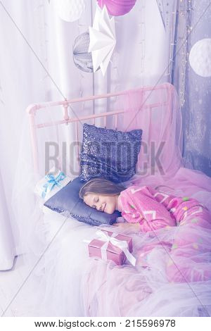 Smiling Teenage Girl Is Sleeping Sweetly In A Christmas