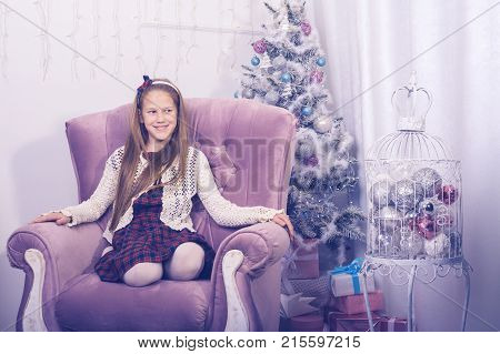 Happy Girl Teenager In Front Of A Christmas Tree
