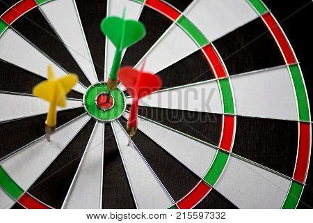 A Dart stuck in a dartboard poster