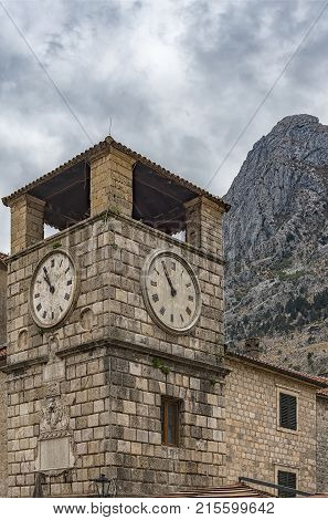 The Clock Tower on the Square of Arms in the Old Town of Kotor Montenegro. The Old Town of Kotor is a UNESCO World Heritage site and a famous tourist attraction.