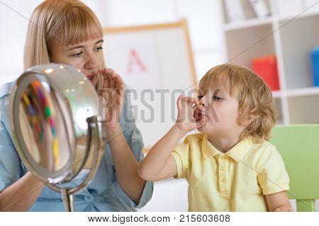 Cute child boy at speech therapist office