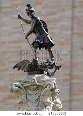 URBINO, ITALY - JUNE 14, 2017: Copy of bronze statue of San Crescentino on a marble column. The statue installed in 2009, and since that time this site is called Largo San Crescentino