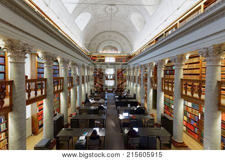 HELSINKI, FINLAND - NOVEMBER 6, 2017: People in the National Library of Finland. The building was erected in 1832 by design of the architect Carl Ludvig Engel