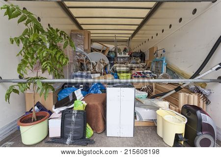 Fully loaded moving truck with diverse household items