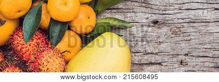 Banner, Long Format Colorful Fruits On The White Wooden Table, Bananas, Carambola, Mango, Papaya, Ma