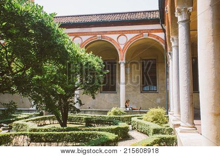 Milan, Italy - July 14, 2013: Courtyard Garden And Colonnade Of The Science And Technology Museum Le