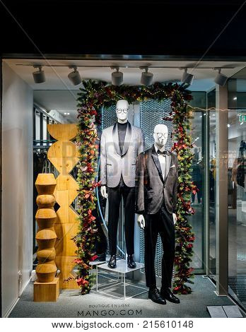 STRASBOURG FRANCE - NOV 21 2017: Windows of the decorated Mango Store windows facade with mannequins wearing latest male fashion collection