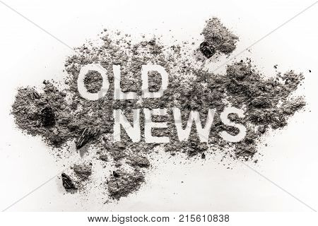 Old news word text written in ash dust or dirt as old expired and outdated information or newspaper concept background