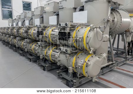 High voltage gas insulated switchgear (GIS) in utility substation.